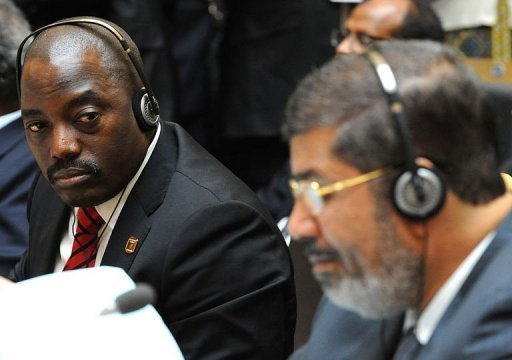 &lt;p&gt;Democratic Republic of Congo&#39;s President Joseph Kabila (L) looks at Egypt&#39;s newly-elected president Mohamed Morsi during the African Union summit in Addis Ababa. Kinshasa and Kigali have agreed to accept an international force to neutralise militias in eastern DR Congo and patrol their border, Rwandan President Paul Kagame told AFP Sunday.&lt;/p&gt;