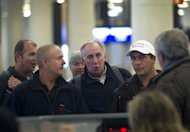 Employees of British oil giant BP wait for their flight back to London at the Palma de Mallorca airport on January 18, 2013. Islamist gunmen were holed up with an unknown number of foreign hostages on Saturday at a gas plant in the Algerian desert, amid uncertainty over what the army was doing to free their captives