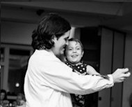 My fiance dancing with our daughter.