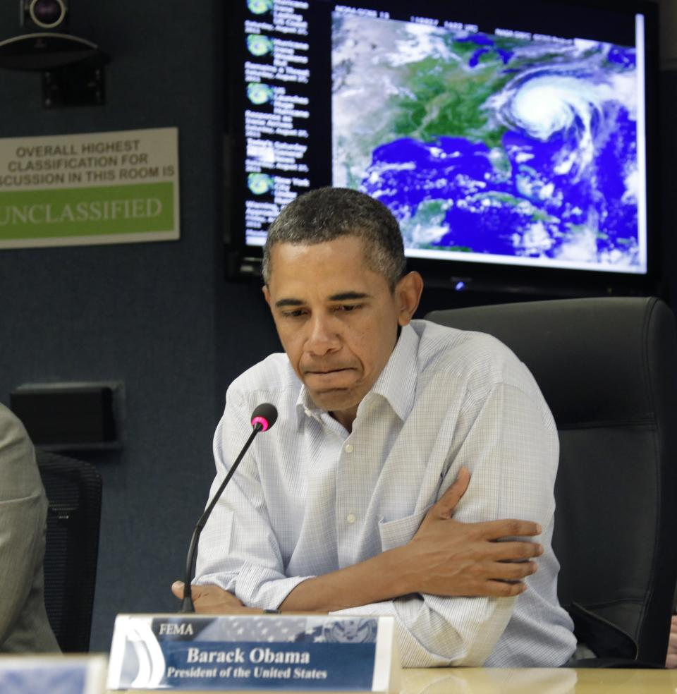 President Barack Obama gets an update on the status of Hurricane Irene at the Federal Emergency Management Agency (FEMA) Headquarters in Washington, Saturday, Aug. 27, 2011.  (AP Photo/J. Scott Applewhite)