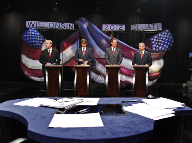 FILE - In this Aug. 10, 2012, file photo Republican candidates for the U.S. Senate, Wisconsin Assembly speaker Jeff Fitzgerald, from left, R-Horicon, Eric Hovde, former U.S. Rep. Mark Neumann and former Wisconsin Gov. Tommy Thompson, right, prepare before their debate in Madison, Wis. Even with the name of Thompson on the ballot, the biggest name in modern Wisconsin politics, the Republican primary in a highly competitive U.S. Senate race appears headed for a fractious four-way face off in the Aug. 14 primary. (AP Photo/Andy Manis, File)