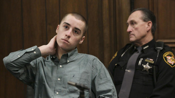 T. J. Lane listens during court proceedings at the Geauga County Common Pleas Court Tuesday, Feb. 26, 2013, in Chardon, Ohio. Lane, charged with killing three students at an Ohio high school pleaded guilty Tuesday to three counts of aggravated murder and other charges. Lane, now 18, also pleaded guilty to two counts of attempted aggravated murder and a single count of felonious assault. Prosecutors agreed to drop the death-penalty specifications from the aggravated murder counts.(AP (Photo/Marvin Fong, Pool)