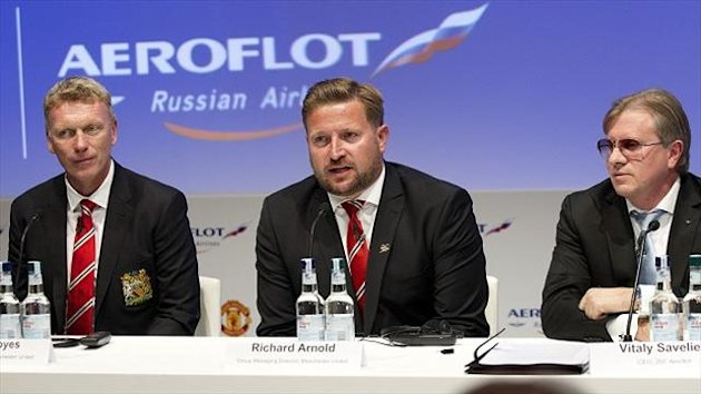 Richard Arnold, centre, has been happy with the change at Manchester United