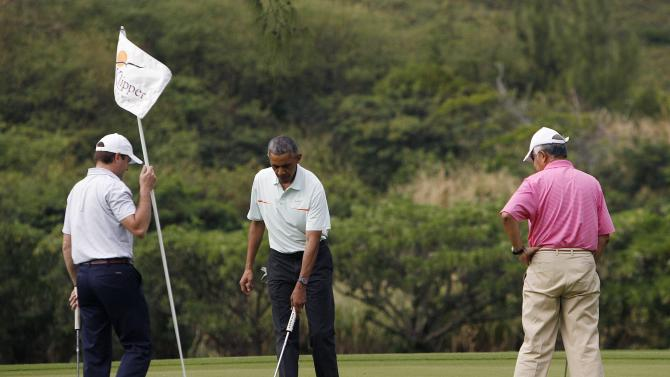 U.S. President Barack Obama, Malaysia's Prime Minister Najib Razak and White House Aid Joe Paulsoen finish up on the 18th hole in Hawaii