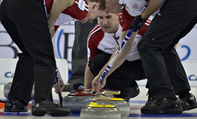 Newfoundland skip Gushue watches as teammates Casey and Walker sweep during play at the Canadian Men's Curling Championships in Edmonton