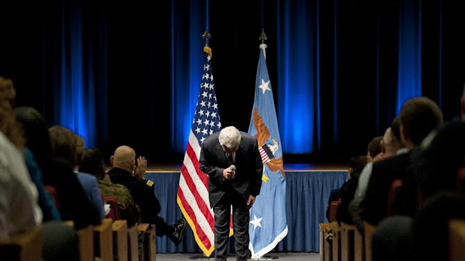 New Defense Secretary Chuck Hagel bows as he concludes his remarks to service members and civilian employees at the Pentagon, Wednesday, Feb. 27, 2013, after being sworn-in. Hagel took charge of the Defense Department Wednesday after a bruising confirmation fight _ and two days before billions in budget cuts are scheduled to hit the military. (AP Photo/Cliff Owen)
