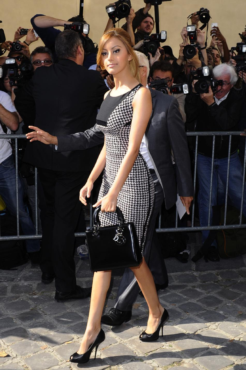 Zahia Dehar arrives to attend Christian Dior's ready-to-wear Spring/Summer 2014 fashion collection, presented Friday, Sept. 27, 2013 in Paris. (AP Photo/Zacharie Scheurer)