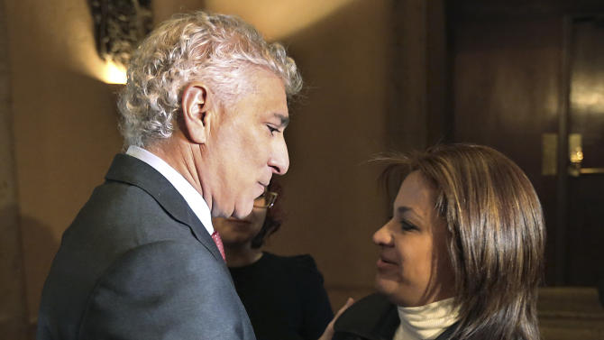 Attorney Paul Kiesel, left, embraces Cynthia Rivera, sister of Arturo Rivera, to announce a lawsuit on behalf of Arturo Rivera and three other associates of Mexican singer Jenni Rivera, who perished along with her in a plane crash in Mexico in December, at a news conference in Los Angeles Thursday, Jan. 10, 2013. Cynthia Rivera and Arturo Rivera are not related to Jenni Rivera. (AP Photo/Reed Saxon)