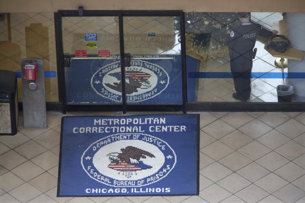 A Chicago police officer stands guard in the lobby of the Metropolitan Correctional Center Tuesday, Dec. 18, 2012, in Chicago. Two convicted bank robbers used a knotted rope or bed sheets to escape fr