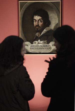 "FILE - In this Thursday, Feb. 10, 2011 file photo visitors admire the portrait of Caravaggio by an unknown painter during the presentation to journalists of an exhibit dedicated to the Lombard painter titled: ""Caravaggio in Rome"", in Rome. Two Italian art historians are claiming, Thursday, July 5, 2012, to have identified dozens of drawings as those of a very young Caravaggio in a collection of works of a master painter he studied under in the late 1500s. There was no immediate way to verify the claim. One noted expert of 16th century art familiar with the drawings said it was likely that at most only a few were done by Caravaggio, but that in any case none show the mature hand of the artist. (AP Photo/Pier Paolo Cito, File)"