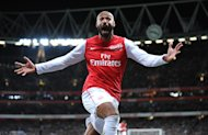 Thierry Henry celebrates scoring during his second spell at Arsenal last season