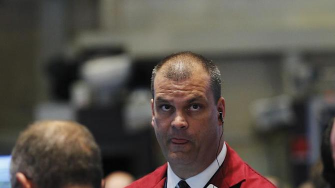 A trader looks up at a screen while working on the floor of the New York Stock Exchange
