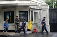 Philippine police secure the entrance to the US embassy compound in Pasay, a major district of Manila. More Western nations have called on their citizens to be cautious in the Philippine capital following a US embassy warning a day earlier of an unspecified threat against Americans