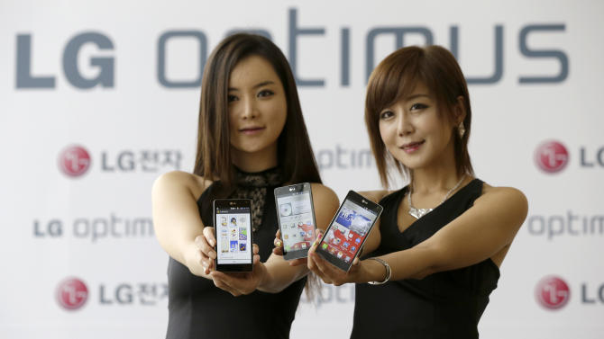 Models pose with LG Electronics' new smartphone the Optimus G during its unveiling ceremony in Seoul, South Korea, Tuesday, Sept. 18, 2012. LG Electronics will launch the Optimus G smartphone next week in South Korea, pinning hope on the new Android device to help revive its loss-making mobile business. (AP Photo/Lee Jin-man)