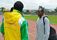 Ethiopian 10,000 meter runner, Ibrahim Jelan (R), pictured after practice in Addis Ababa, on July 3. Jelan -- who will be competing in the 10,000 meter trial in Brussels on July 5 said he has high hope for his colleagues, both at this week's qualifying races and at the Olympic Games, with so many up-and-coming athletes taking part