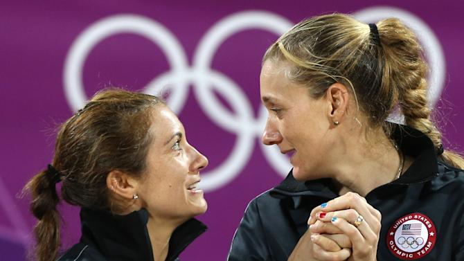 United States' Kerri Walsh Jennings, right, and Misty May-Treanor, left, react during a podium ceremony after winning the women's gold medal beach volleyball match at the 2012 Summer Olympics, Wednesday, Aug. 8, 2012, in London. (AP Photo/Petr David Josek)