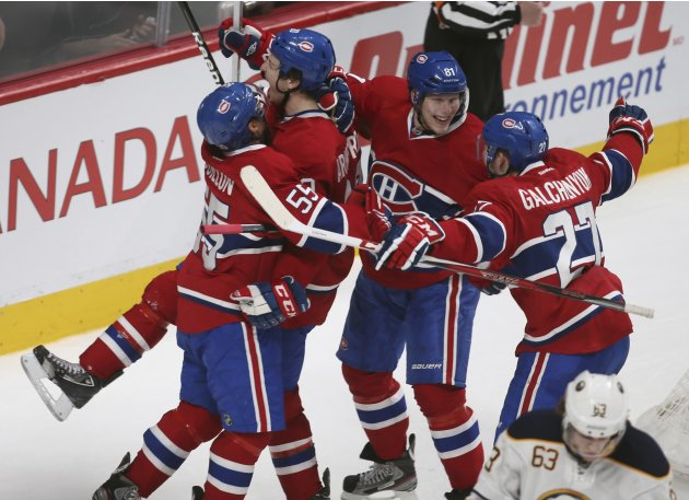 Montreal Canadiens' Armstrong celebrates goal over Buffalo Sabres goalie Enroth to send the game to overtime, during third period NHL hockey action in Montreal