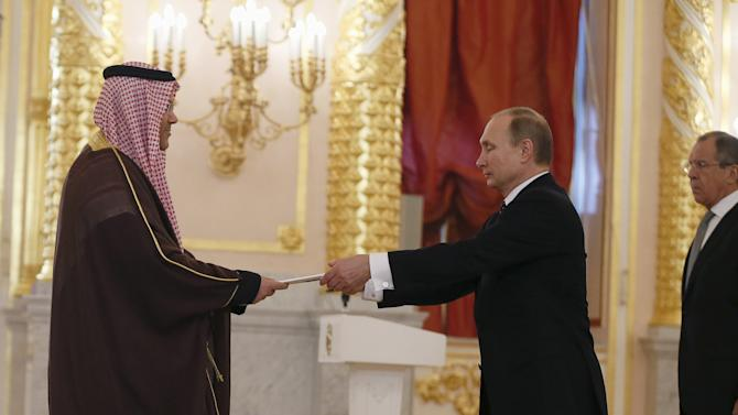 Russian President Vladimir Putin receives diplomatic credentials from Bahraini ambassador to Russia Ahmed Abdulrahman Mahmoud Ismail al-Saati during a ceremony at the Kremlin in Moscow