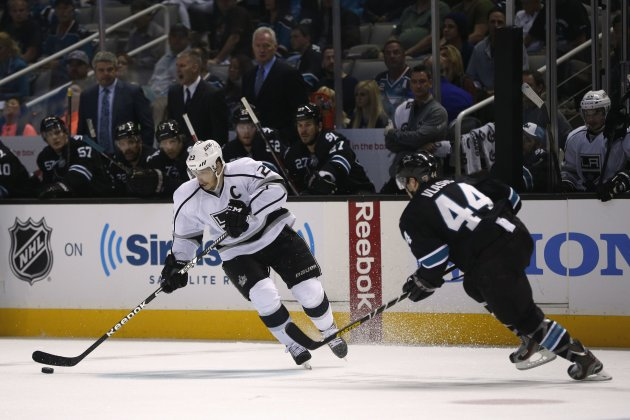 Kings' Brown drives the puck while being pressured by Sharks' Vlasic in the second period during Game 3 of their NHL Western Conference semifinal playoff hockey game in San Jose