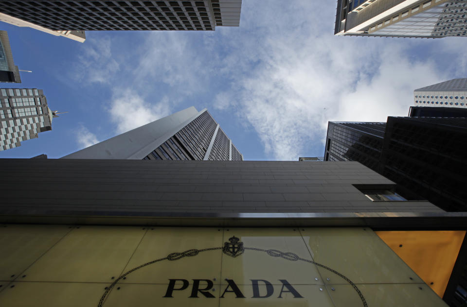 A logo of Prada is seen at a store in Hong Kong Sunday, June 12, 2011. Prada and its bankers say an international roadshow to promote the Italian fashion house's upcoming Hong Kong IPO is going well despite recent turmoil in world stock markets. Prada is selling some 423.3 million shares in an initial public offering this month. (AP Photo/Vincent Yu)