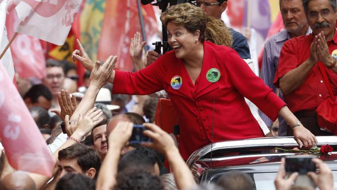Brazil's President and Workers' Party presidential candidate Dilma Rousseff greets supporters during a campaign rally in Porto Alegre