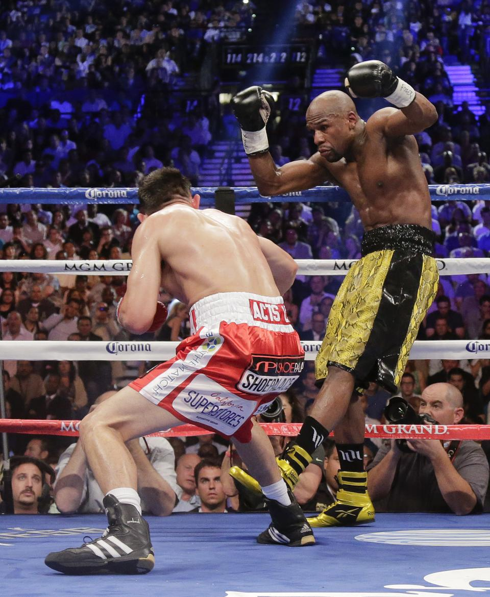 Floyd Mayweather Jr. dodges a punch by Robert Guerrero in the third round during a WBC welterweight title fight, Saturday, May 4, 2013, in Las Vegas. Mayweather won by unanimous decision. (AP Photo/Rick Bowmer)