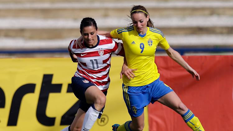Ali Krieger, left, of the US, fights for the ball with Sweden's Kosovare Asllani during their Algarve Cup  women's soccer match Monday, March 11 2013, in Lagos, southern Portugal. (AP Photo/Armando Franca)