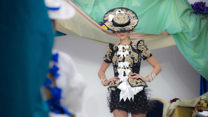 Models wear designs from the Spring/Summer 2013 Meadham Kirchoff collection at a central London  venue, during London Fashion Week, Tuesday, Sept. 18, 2012. (AP Photo/Joel Ryan)