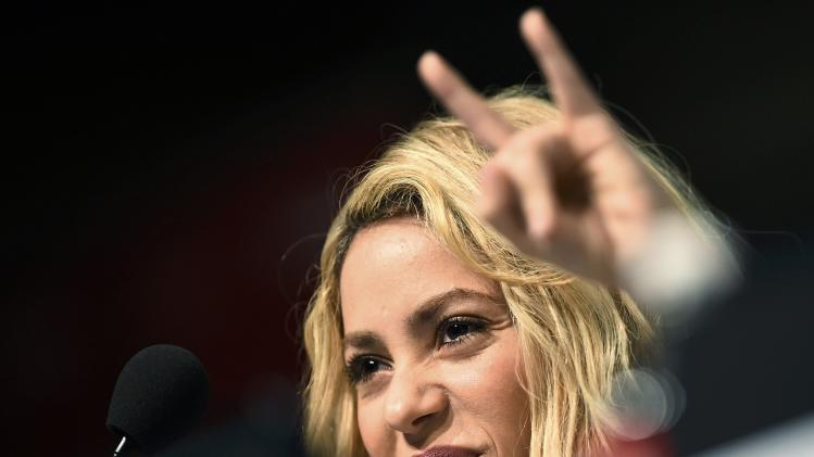 Colombia singer Shakira smiles during a news conference at the Maracana stadium in Rio de Janeiro