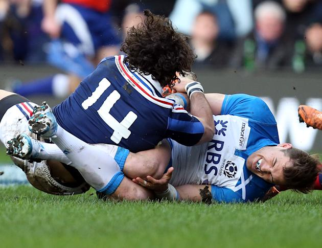 Scotland's Sean Lamont, right, tackles France's Yohan Huget during their Six Nations rugby union international match at Murrayfield in Edinburgh, Scotland, Saturday March 8, 2014. (AP Photo/Sc