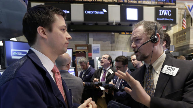 Specialist Robert Canzani, left, and trader Robert Moran, right, work on the floor of the New York Stock Exchange Tuesday, March 19, 2013. A surprisingly strong increase in new home construction is sending stocks higher in early trading on Wall Street. (AP Photo/Richard Drew)