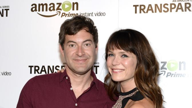 """Actors Mark Duplass and Katie Aselton Duplass pose during Amazon's premiere screening of """"Transparent"""" at the Ace Hotel in downtown Los Angeles"""