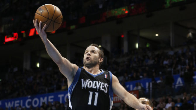 Minnesota Timberwolves guard Jose Barea (11) shoots in front of Oklahoma City Thunder guard Kevin Martin (23) during the second quarter of an NBA basketball game in Oklahoma City, Friday, Feb. 22, 2013. (AP Photo/Sue Ogrocki)