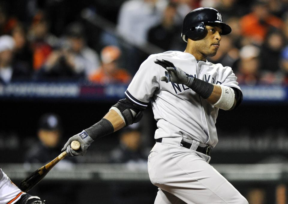 New York Yankees' Robinson Cano doubles in the first inning of Game 2 of the American League division baseball series against the Baltimore Orioles on Monday, Oct. 8, 2012, in Baltimore. Ichiro Suzuki, of Japan, scored on the play. (AP Photo/Nick Wass)