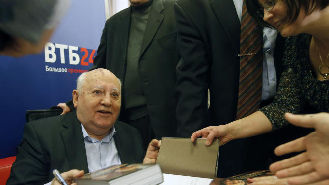 Former Soviet leader Mikhail Gorbachev signs his book in a book shop in Moscow, Russia, Tuesday, Nov. 13, 2012. Mikhail Gorbachev looks back at his life in his new book Alone with Myself. He talks about his young years with a remarkable candor in the book, which is full of love for his late wife.  (AP Photo/Misha Japaridze)