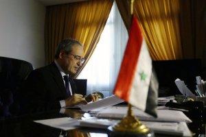 Syrian deputy Foreign Minister Faisal Muqdad poses…