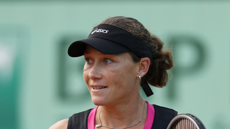 Australia's Samantha Stosur clenches her fist as she defeats USA's Sloane Stephens during their fourth round match in the French Open tennis tournament at the Roland Garros stadium in Paris, Sunday, June 3, 2012.  (AP Photo/Bernat Armangue)