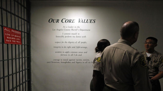 """The Los Angeles County Sheriff's Department's """"Core Values"""" are displayed on a wall at the Men's Central Jail in downtown Los Angeles Wednesday, Oct. 3, 2012. Los Angeles County Sheriff Lee Baca says he plans to implement all the reforms suggested by a commission in the wake of allegations that a culture of violence flourished in his jails. (AP Photo/Reed Saxon)"""