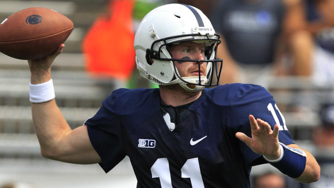 Penn State quarterback Matt  McGloin (11) looks to pass against Ohio during the first quarter of an NCAA college football game at Beaver Stadium in State College, Pa., Saturday, Sept. 1, 2012. (AP Photo/Gene J. Puskar)