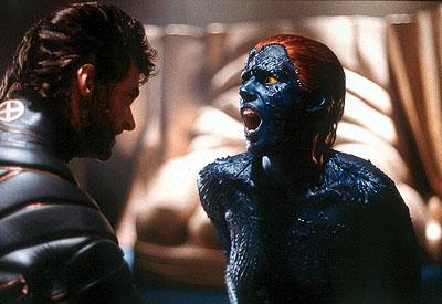 Hugh Jackman as Wolverine squares off against Rebecca Romijn Stamos as Mystique in 20th Century Fox's X-Men