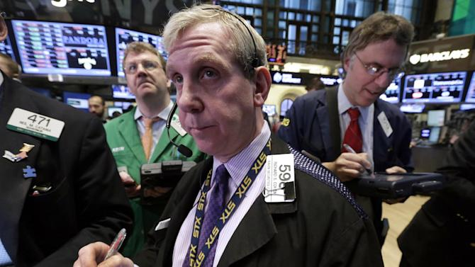 Richard Cohen, center, works with fellow traders on the floor of the New York Stock Exchange Tuesday, Jan. 8, 2013. U.S. stocks opened mostly lower Tuesday as traders awaited the start of U.S. corporate earnings season. (AP Photo/Richard Drew)