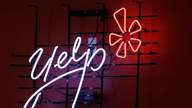 FILE - In this Oct. 26, 2011 file photo, the logo of the online reviews website Yelp is shown in neon on a wall at the company's new Manhattan offices in New York. Online reviews site Yelp is expected to price its initial public offering of stock on Thursday , March 1, 2012, and become the latest in a long line of social websites going public.  (AP Photo/Kathy Willens, File)
