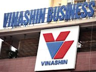 Logo of Vietnam&#39;s state-owned shipbuilder Vinashin group is pictured at its headquarters in Hanoi, in 2010. Former top executives at the Vietnamese shipbuilder whose huge debts shook investor confidence in the communist nation went on trial on Tuesday for defying state regulations