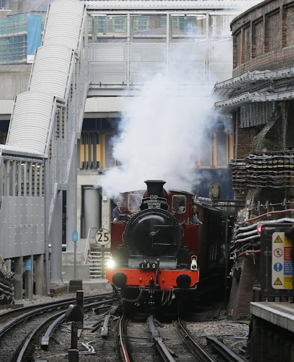 Metropolitan 1, a restored steam train built in 1898, passes through Farringdon Tube station on it's journey between Olympia Tube station in the west to Moorgate station in the City of London, Sunday,