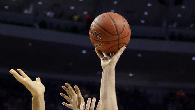 Wisconsin's Jared Berggren shoots over Michigan's Jon Horford during the first half of an NCAA college basketball game at the Big Ten tournament Friday, March 15, 2013, in Chicago. (AP Photo/Nam Y. Huh)