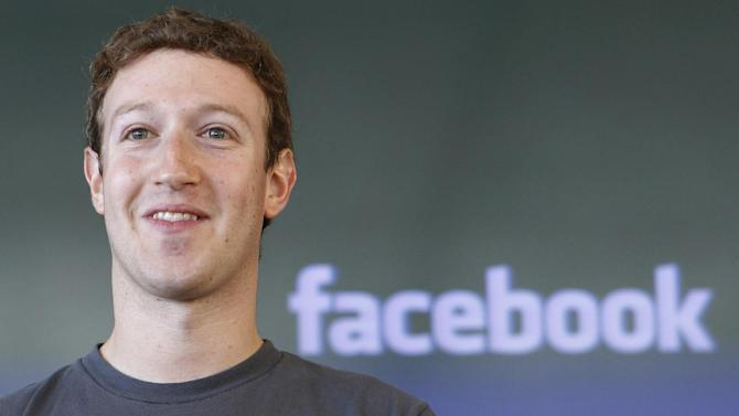 """FILE - This Oct. 15, 2011 file photo, shows Facebook CEO Mark Zuckerberg smiling during a meeting in San Francisco. Will Facebook list its stock on the New York Stock Exchange or the Nasdaq? It comes down to """"where Mark Zuckerberg wants to get his picture taken,""""  the founder of one market research company says.  (AP Photo/Paul Sakuma, File)"""