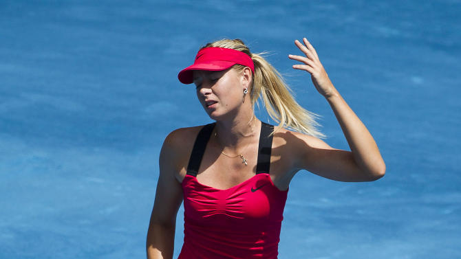 Maria Sharapova from Russia reacts while playing against  Serena Williams from U.S. during the Madrid Open tennis tournament, in Madrid, Friday, May 11, 2012. (AP Photo/Daniel Ochoa de Olza)