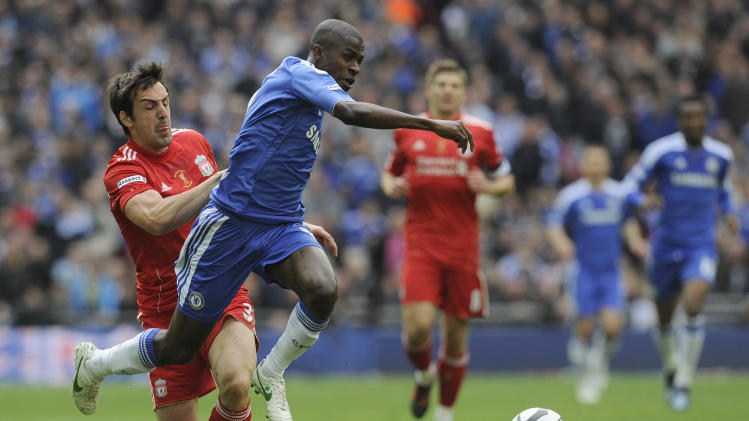 Chelsea's Ramires gets past Liverpool's Jose Enrique as he goes onto score a goal during the English FA Cup Final soccer match at Wembley Stadium in London, Saturday, May 5, 2012. (AP Photo/Tom Hevezi)