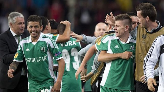 Roman Bezjak (2nd L) of PFK Ludogorets celebrates with teammates his goal against PSV (AFP)