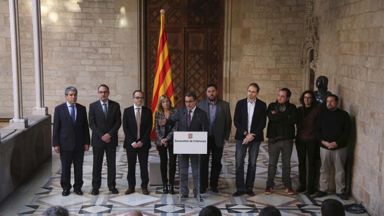 Handout photo of Catalunya's President Mas speaking during a news conference announcing an independence referendum at Palau de la Generalitat in Barcelona
